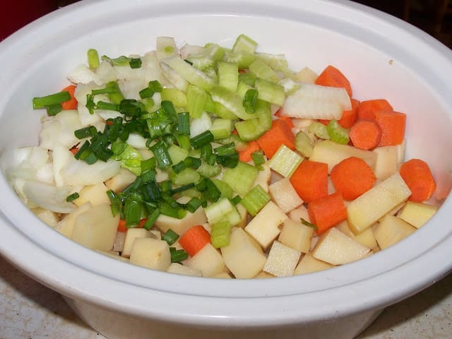 Creamy Crockpot Potato Soup ingredients in pot