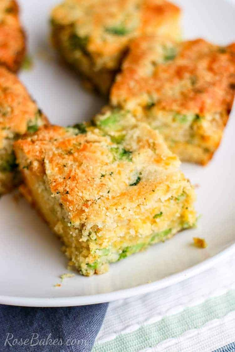 squares of broccoli cheese cornbread on a white plate