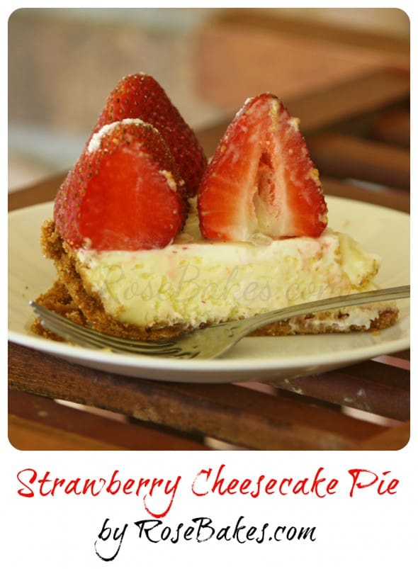 a slice of Strawberry Cheesecake Pie with fresh strawberries on top.