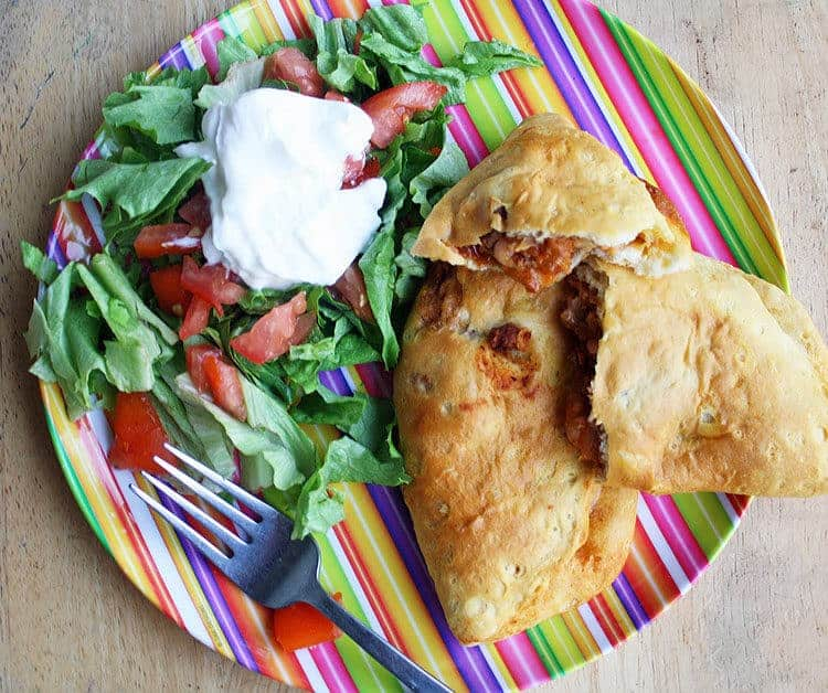 Easy Taco Pockets and Salad on Striped Plate