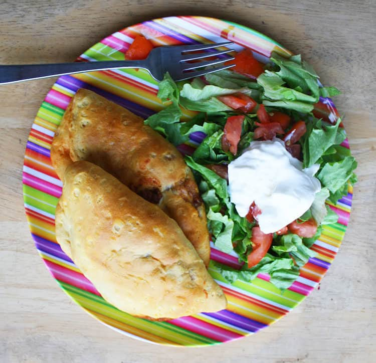 Taco Pockets and Salad on a striped plate