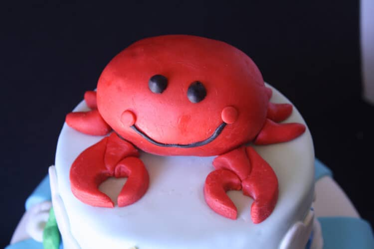 Top tier of cake with crab on top