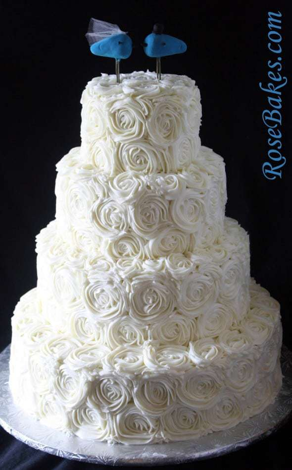 Four Tiered Buttercream Roses Cake with Blue Birds Topper