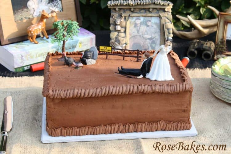 strawberry cake with chocolate icing and a turkey hunting design as topper
