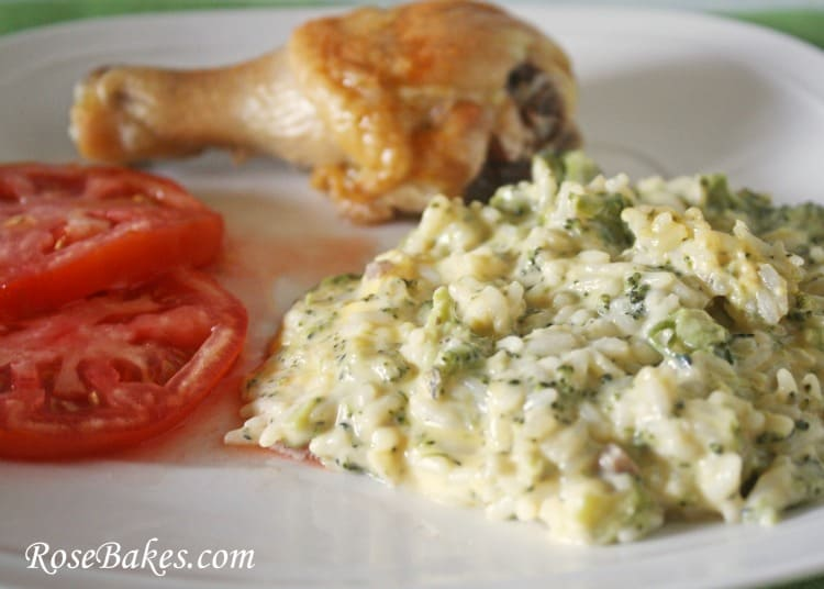 Easy Broccoli Rice & Cheese Casserole served with tomatoes and chicken