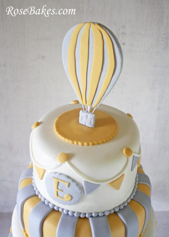 circus baby shower cake with hot air balloon topper