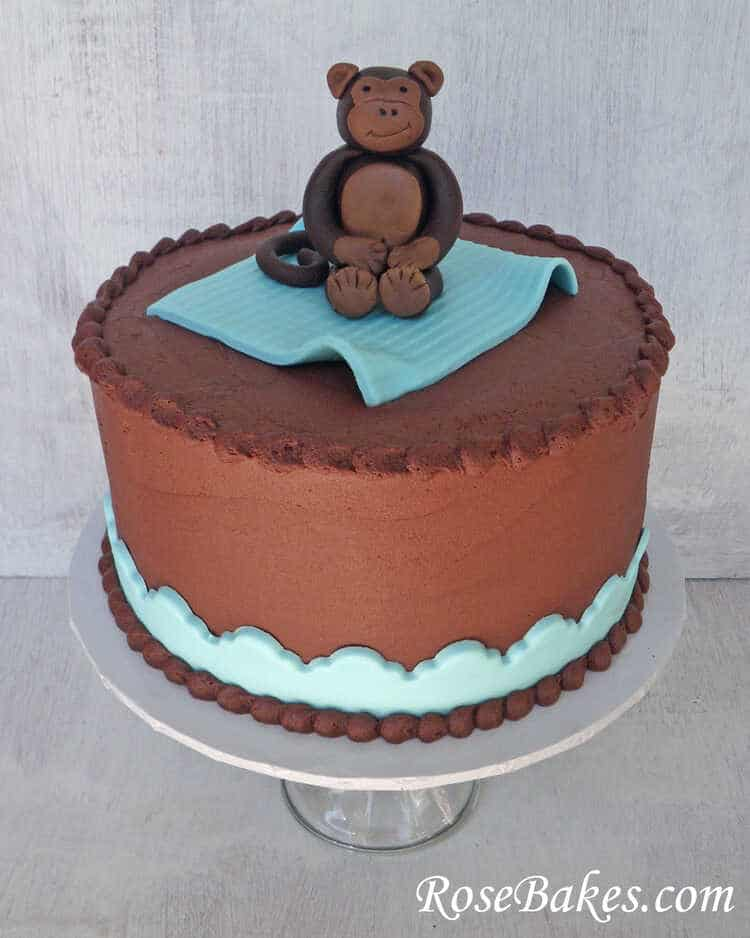 buttercream monkey baby shower cake with fondant monkey cake topper
