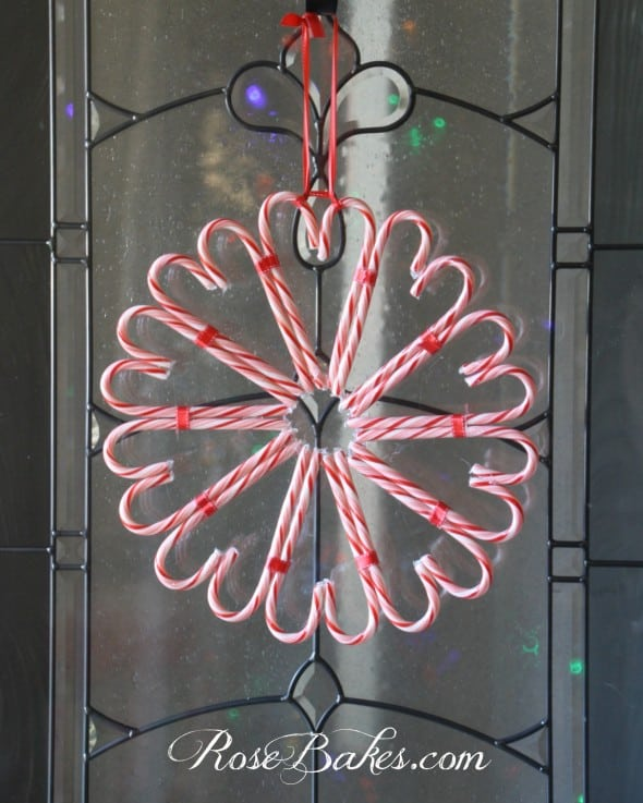 Completed candy cane wreath hanging on a door