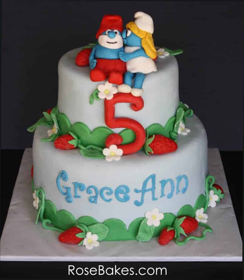 A Smurfs Cake With Strawberries
