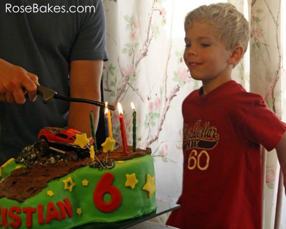 Lighting Candles on the Mud Riding Cake