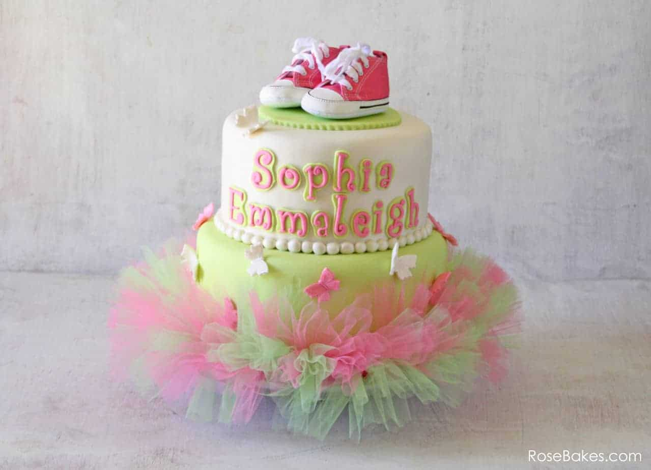 pink green tutu baby shower cake with butterflies and pink converse