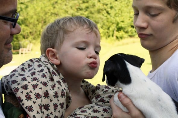 Asher Kissing Puppy