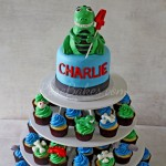 T-Rex Dinosaur Cake and Cupcake Tower