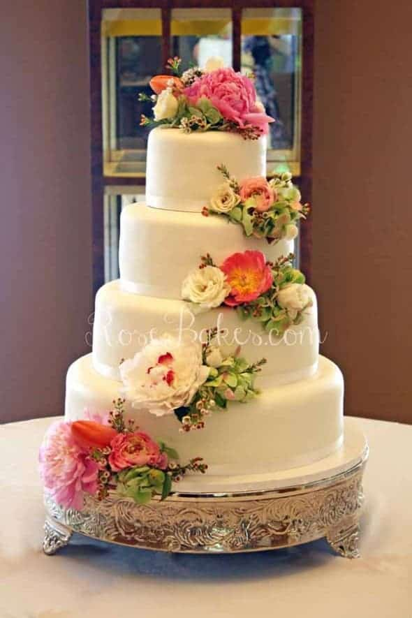 White Wedding Cake with Cascading Fresh Flowers - Rose Bakes