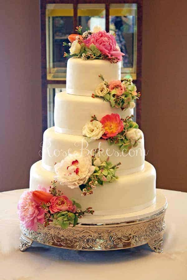 White Wedding Cake With Cascading Fresh Flowers Rose Bakes