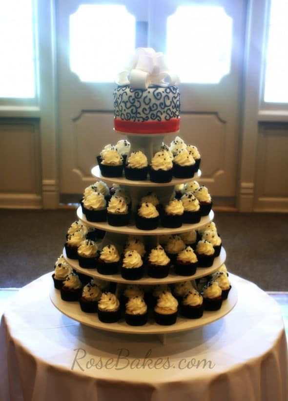 red black and white wedding cake and cupcake tower rose