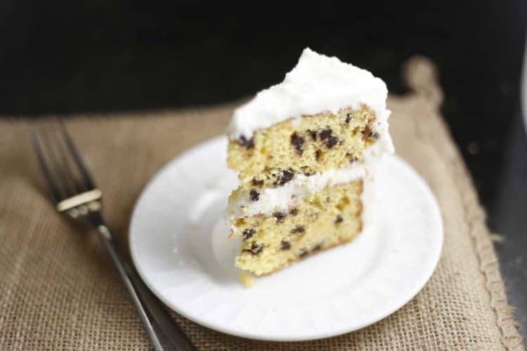 slice of easy chocolate chip cake on white plate with burlap placemat