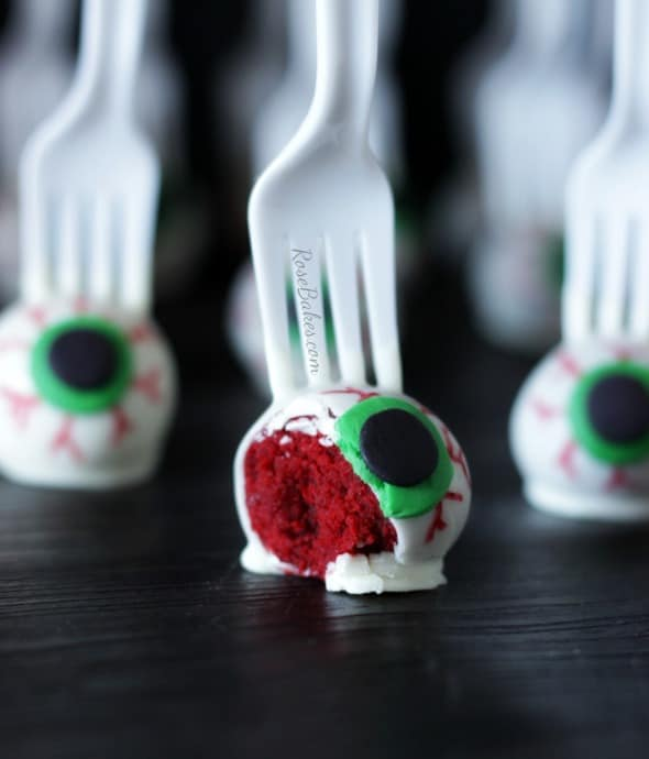 Eyeballs on a Fork Red Velvet Cake Pops - a red velvet cake ball decorated like an eyeball and served on a plastic fork