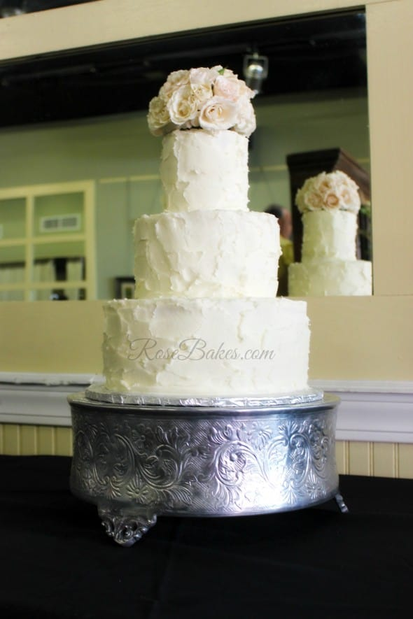 Rustic Buttercream Wedding Cake with Pale Pink Roses 590x885 - Wedding Cakes Country Western Style