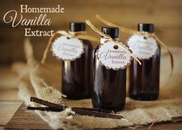 Bottles of Homemade Vanilla Extract with a Vanilla Bean on Burlap