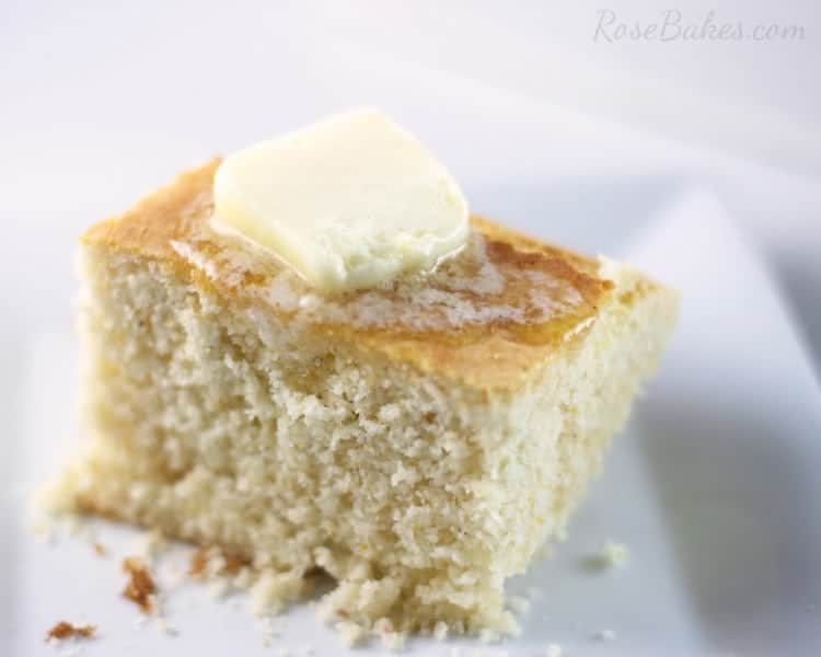 A slice of Southern Buttermilk Cornbread with butter melting on top.
