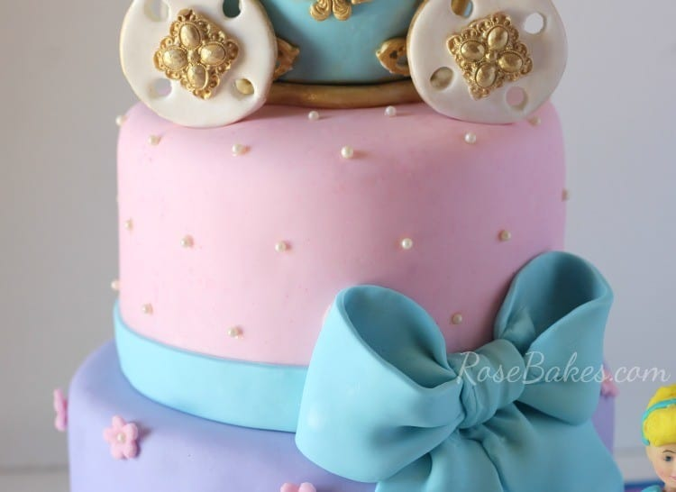 Pink Fondant Cinderella Tier with fondant bow on Cinderella Birthday Cake