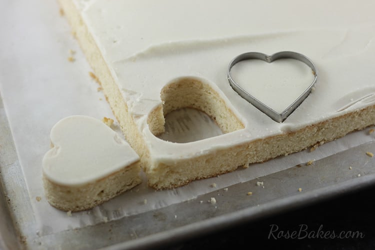 heart cakes cut from sheet of cake with heart cookie cutter