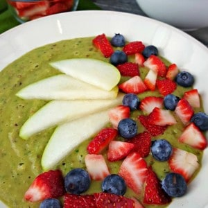 Try-this-Berry-Green-Smoothie-Bowl-topped-with-pears-strawberries-and-blueberries.-Youll-be-surprised-how-good-it-is-and-its-really-good-for-you