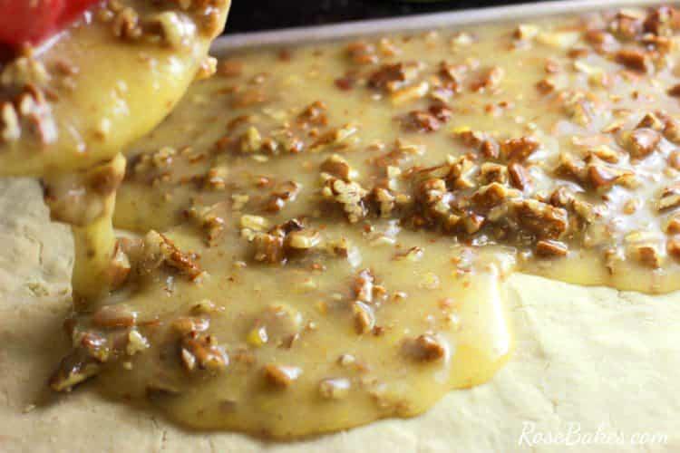 pouring Pecan Pie filling onto shortbread crust for Easy Pecan Pie Bars recipe