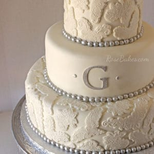lace-and-pearls-wedding-cake-with-silver-accents