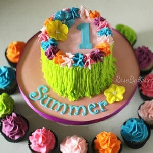luau-party-hula-skirt-cake-with-bright-cupcakes