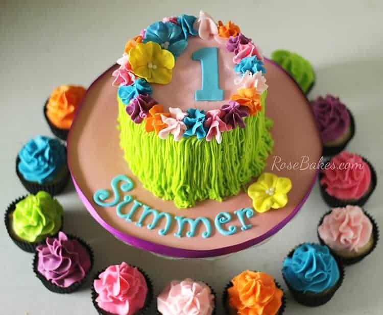 luau-party-hula-skirt-cake-with-bright-cupcakes