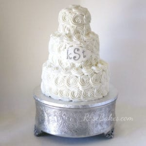 bright-white-buttercream-roses-wedding-cake