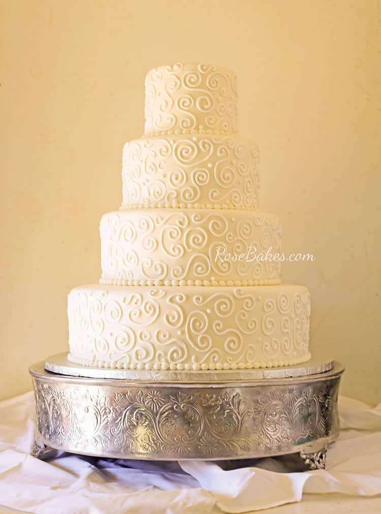 All White Scrollwork Wedding Cake by Rose Bakes