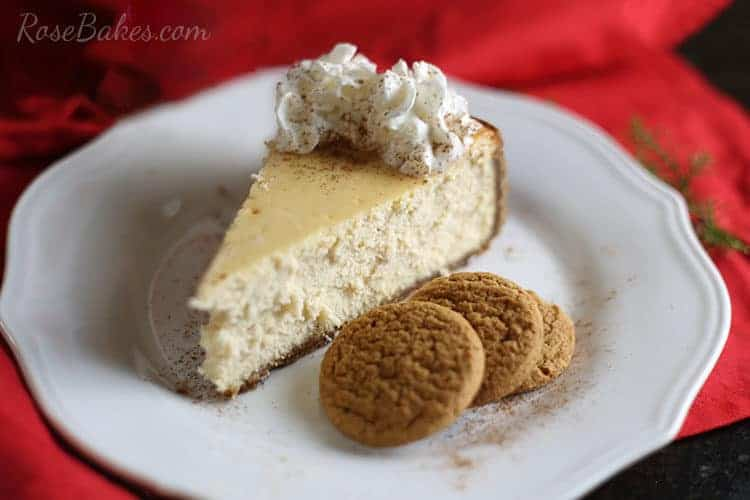 Eggnog Cheesecake with Gingersnap Crust on white plate