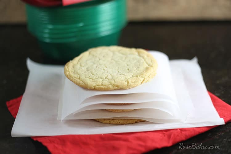 bakery-style-sugar-cookies-stacked-with-parchment-paper
