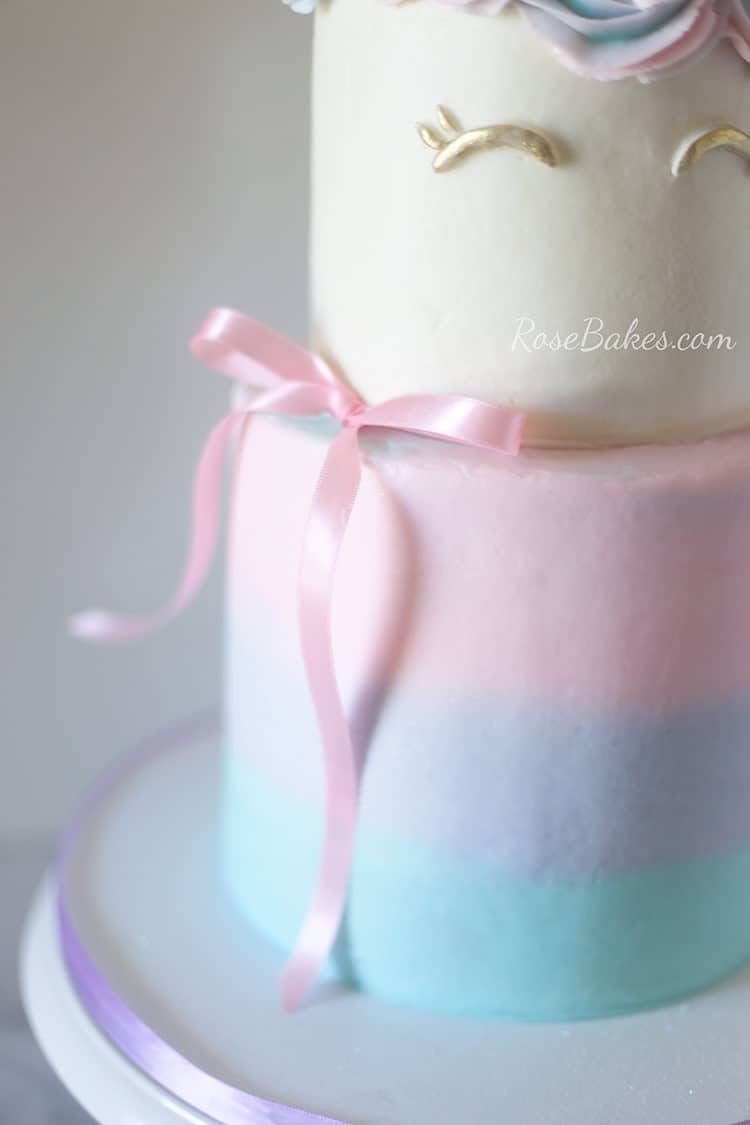 Pink ribbon on buttercream unicorn cake
