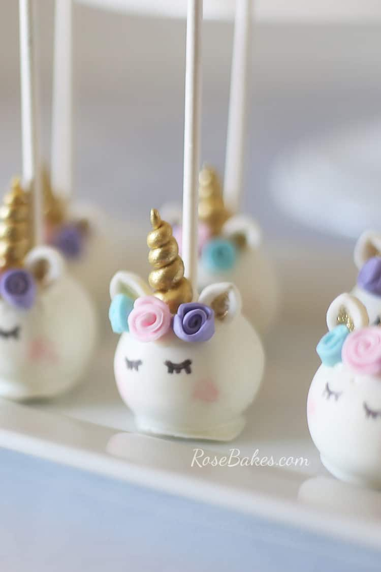 Pastel Unicorn Cake Pops on white platter