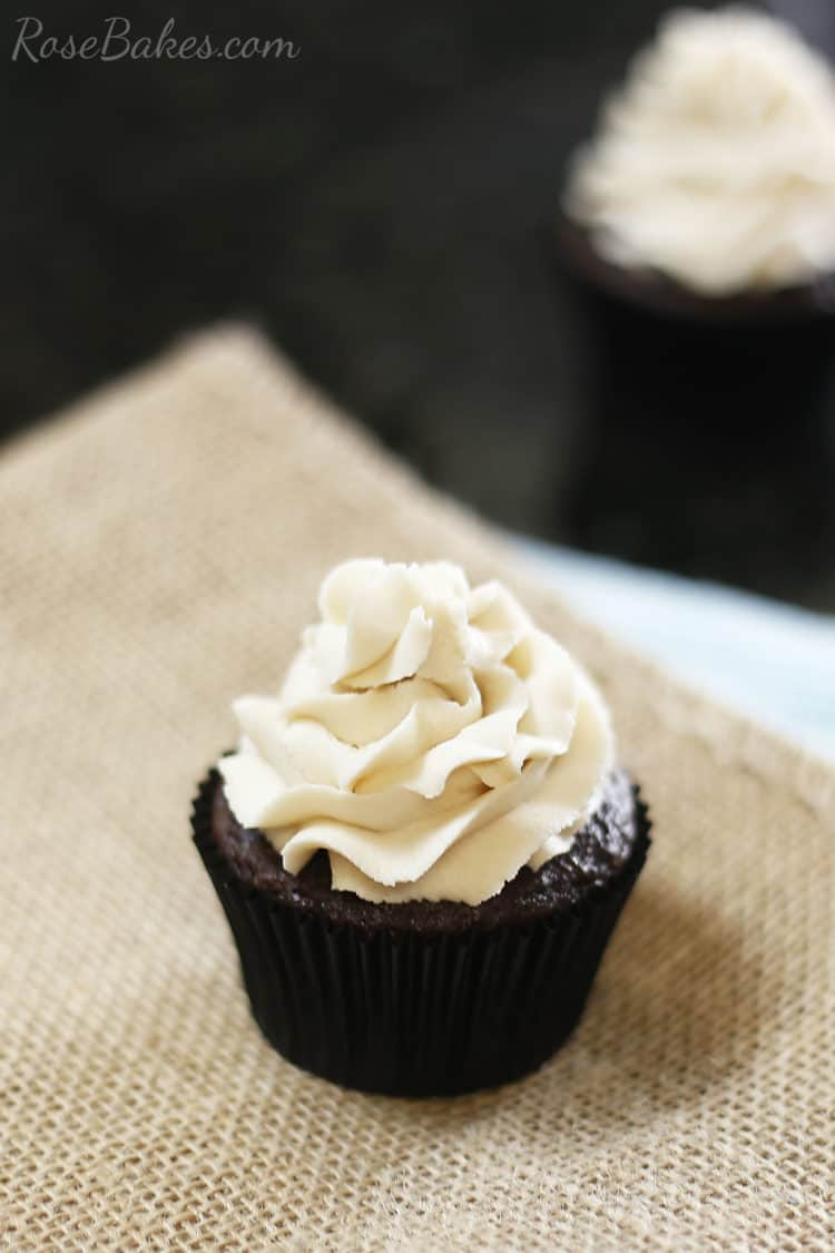Chocolate cupcake with brown sugar buttercream piped on top.