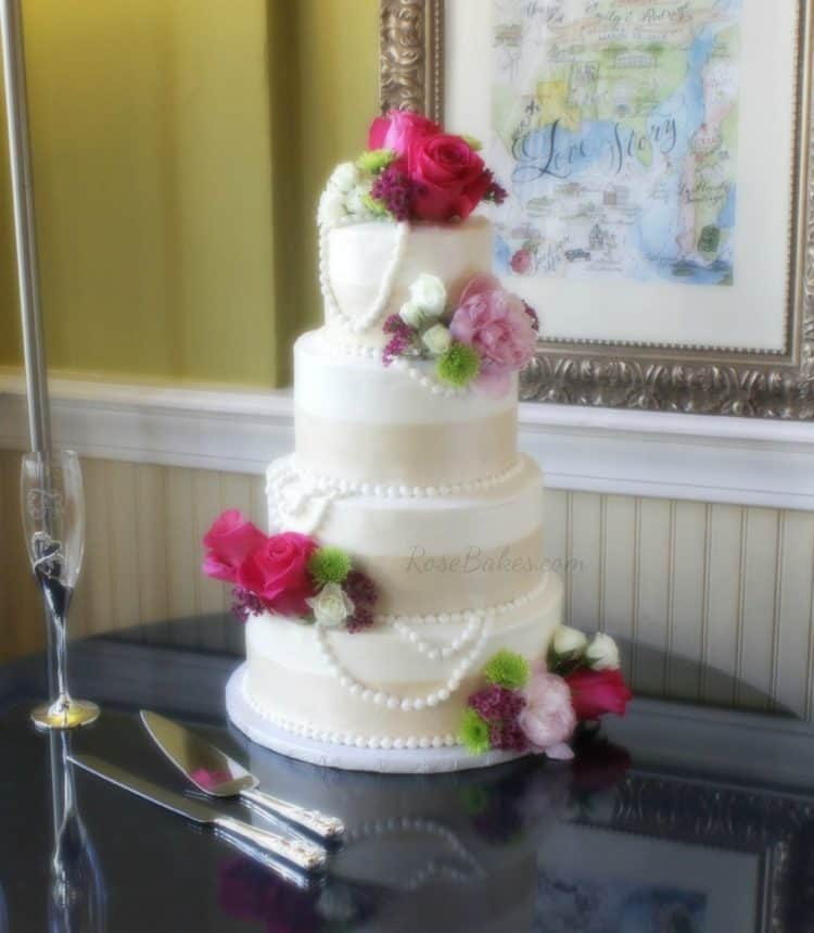 Champagne, Pearls & Hot Pink Flowers Wedding Cake