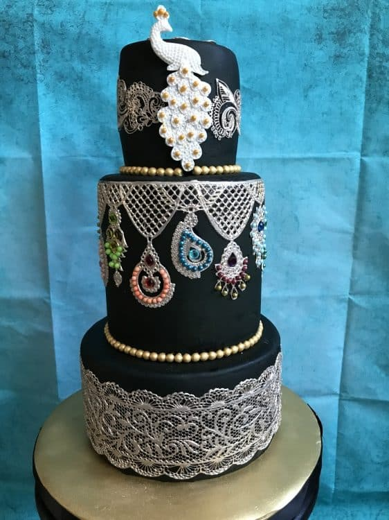 Black and gold peacock cake