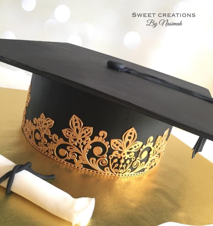 Black and gold lace graduation cap cake