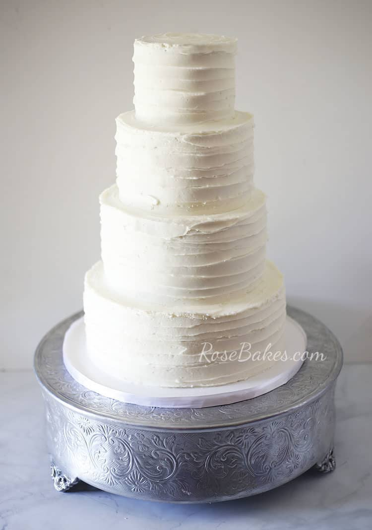 textured wedding cake with ruscus hydrangea rose bakes