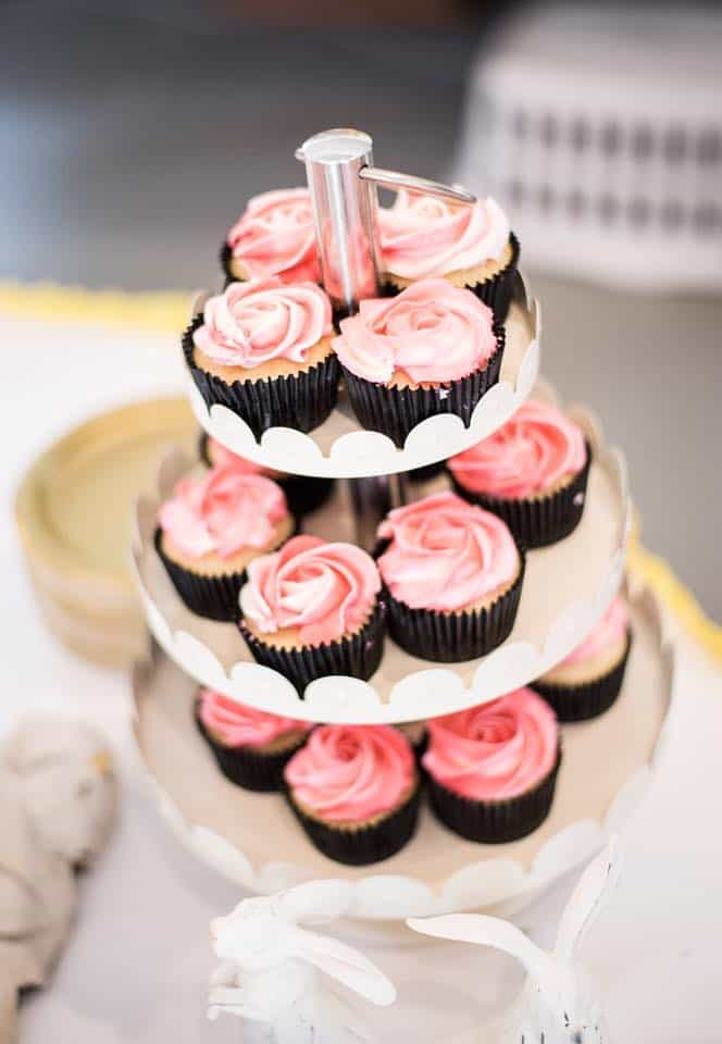 pink cupcakes on white 3 tier display