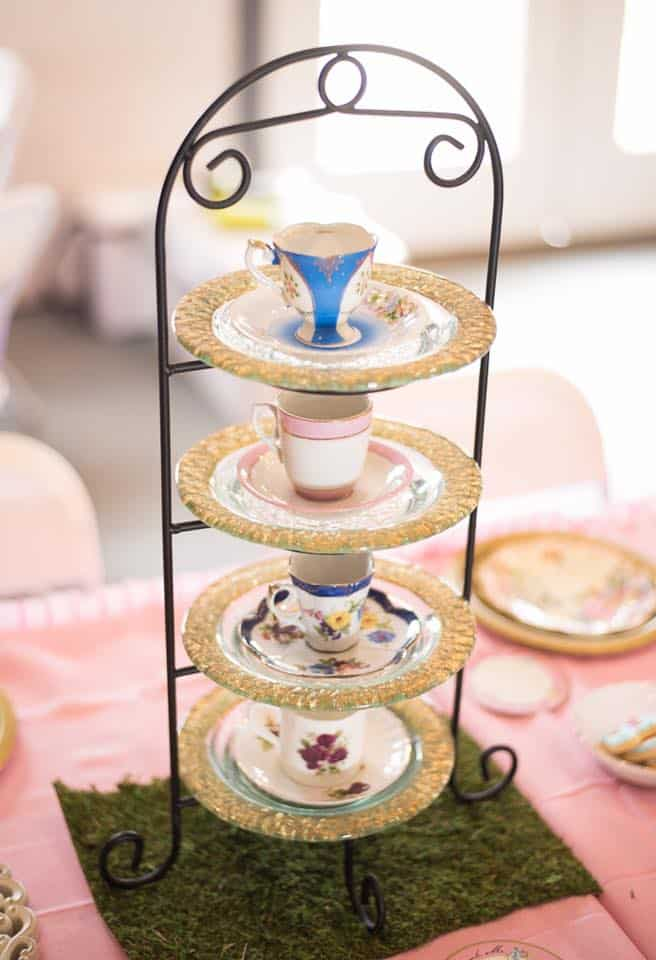 4 tier tea cup and saucer set on display for party