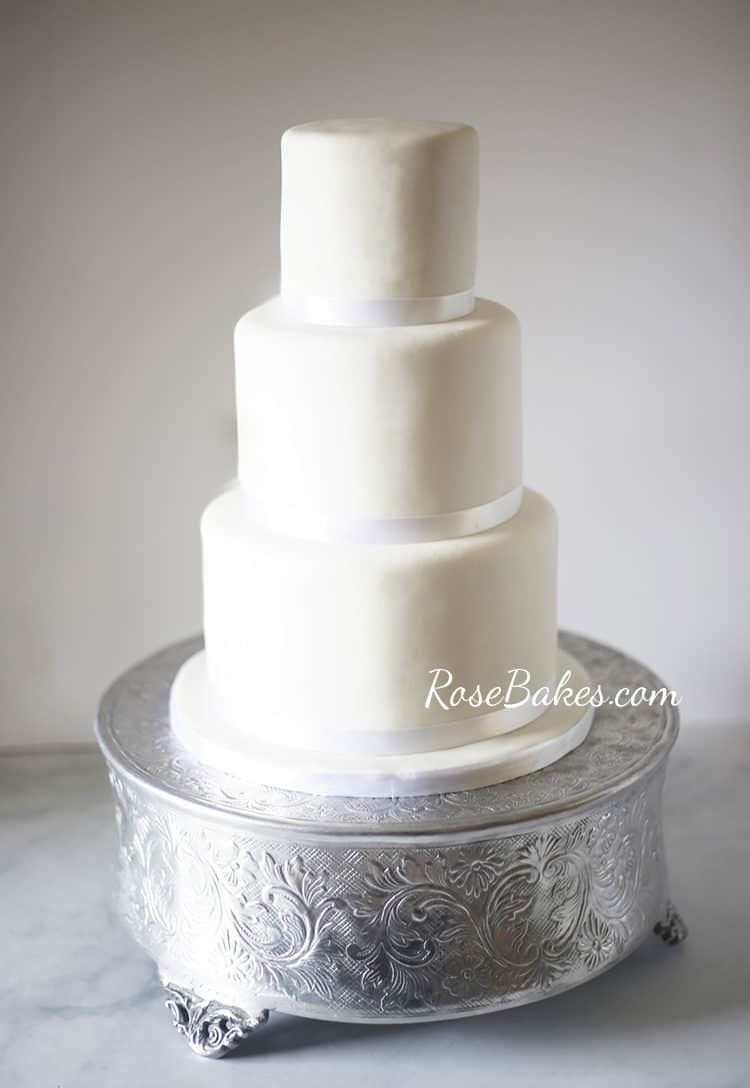 Simple white wedding cake on different cake stands rose bakes the last stand i tried at home was this round silver platform cake stand that is very popular and traditional for weddings my brother jake owns this stand junglespirit Images