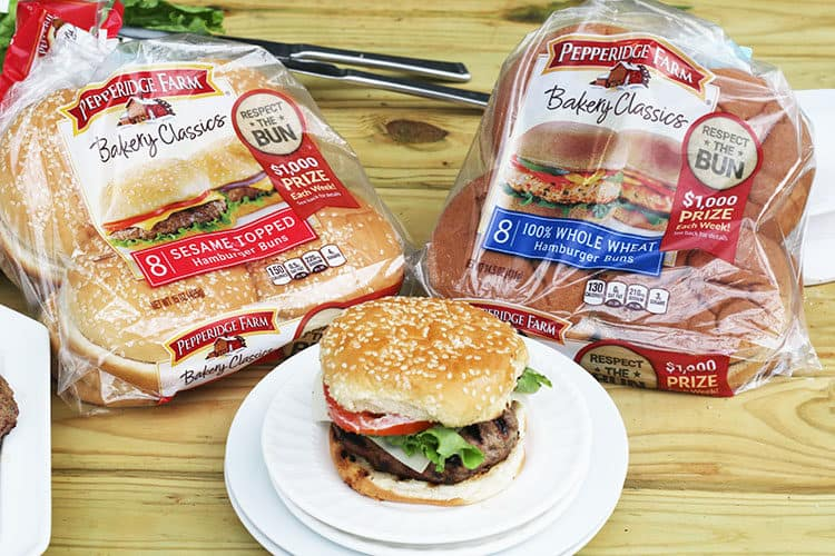 Pepperidge Farms Buns Varieties with a Perfectly grilled burger on a white plate