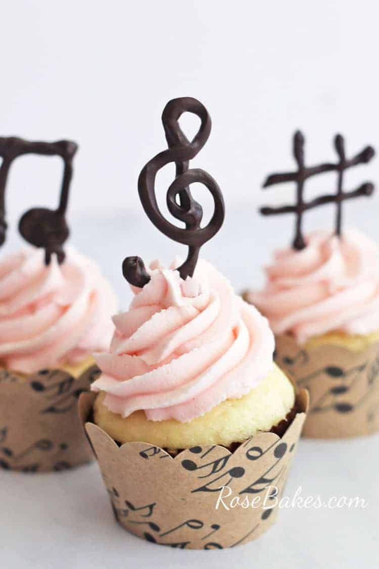 White Cupcakes with Pink Buttercream and Chocolate Music Note Toppers