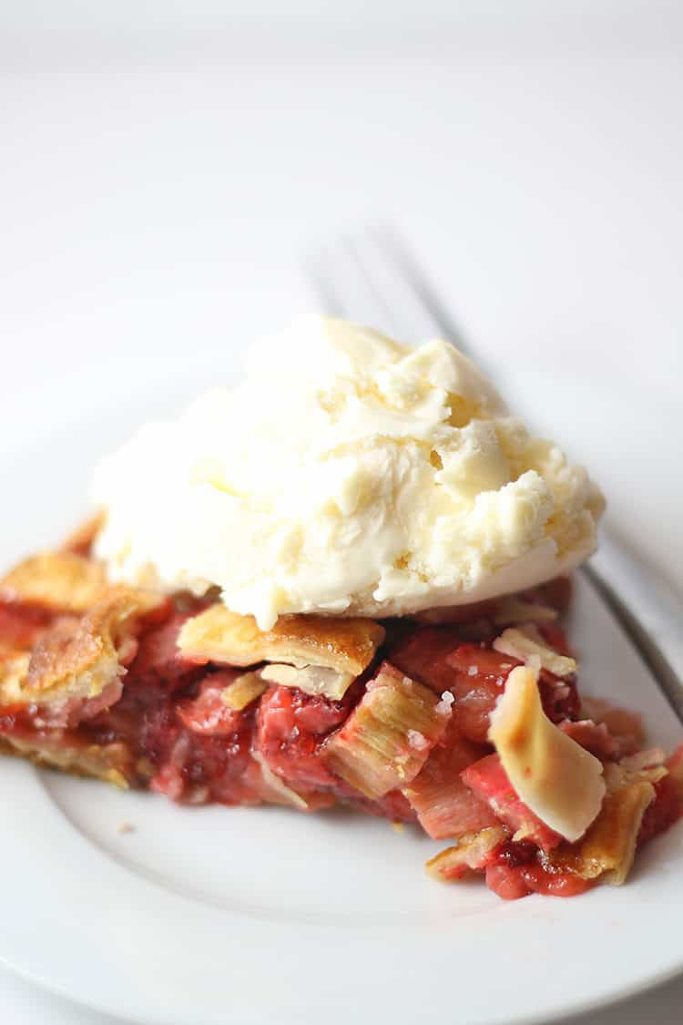 Slice of Strawberry Rhubarb Pie with Ice Cream