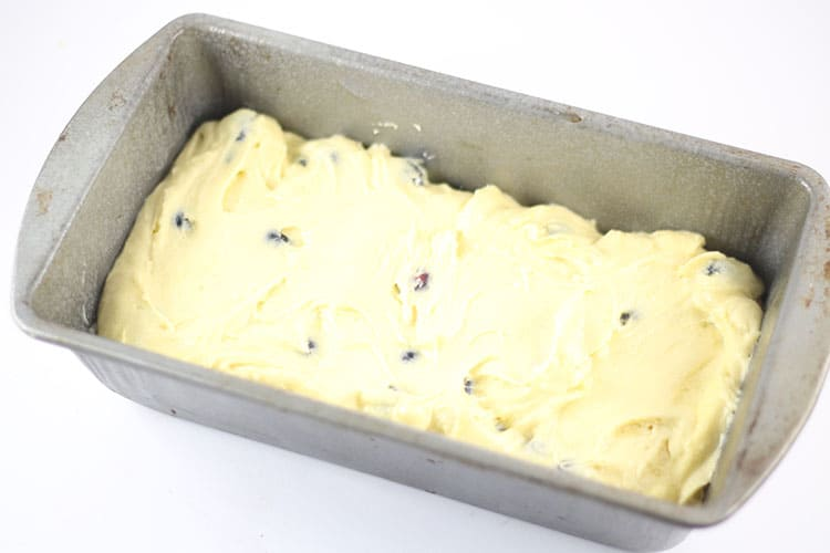 lemon blueberry cake batter in loaf pan